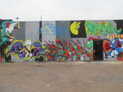Commissioned Wall featuring several Graffiti artists, including Steven Morin