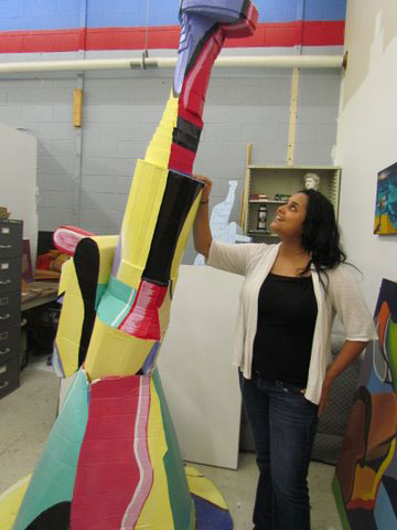 Idalia Gonzales with sculpture